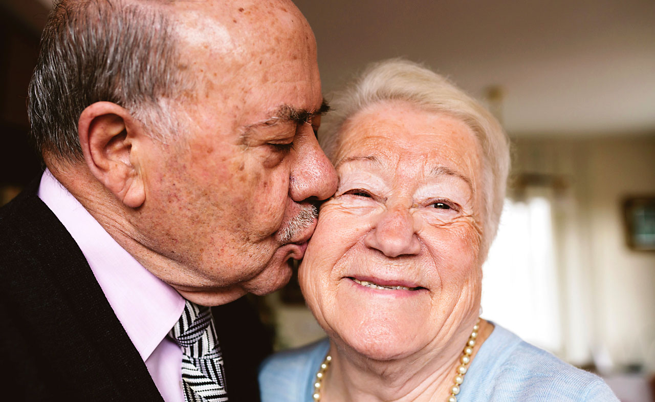 Old man kissing old partner or soulmate